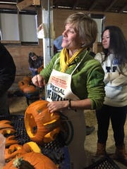 Sue Minter carves a pumpkin for Spookyville Vermont on Oct 15, 2016