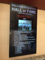 The digital plaque at Milford High School honoring the 1989 boys golf state championship team, inducted into the program's Hall of Fame in 2008. Inductees are shown on a recurring loop.