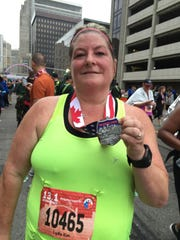 Kim Schiller, 48, of Windsor has lost 50 pounds in three years of running.