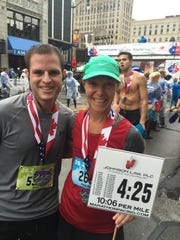 Nancy Damm, right, was a 4:25 pacer (10:06 a mile) for the marathon. Brian Kern, left, kept up with her.