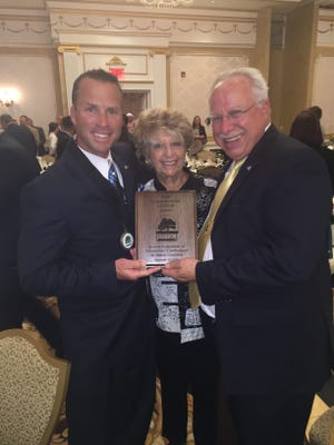 (From left) Dr. Michael Sarnoff, president, Dorris Hecht, treasurer, and Jay Einstein, vice president, of the Jewish Federation of Cumberland, Gloucester and Salem Counties, display the plaque the organization received in recognition of the organization's humanitarian service from the Catholic Charities, Diocese of Camden.