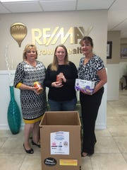 Coastal Van Lines worked with local business in Vero Beach such as RE/MAX Crown Realty to host a community food drive during Hunger Action Month.