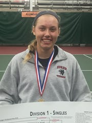 SPASH's Emily Luetschwager poses with the Division 1 singles bracket and her medal at the Nielsen Tennis Stadium signifying a second straight state championship.