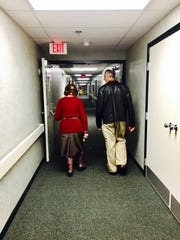Fernanda Walch walks her son, Michael, to the front doors after a visit.