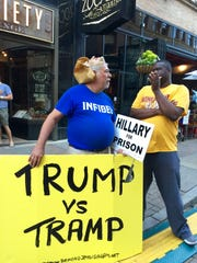 "A man wearing a Hillary Clinton mask and  t-shirt reading ""infidel"" holds a sign supporting Donald Trump during the Republican Convention in Cleveland this summer. The protester is affiliated with the group ""Shalom International,""which organizes Holocaust awareness campaigns."