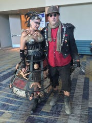Barbara Ellquist and Mike Schifano dress as characters