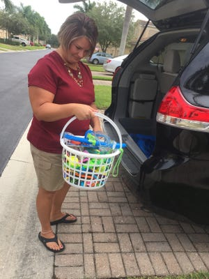 Lisa Lobaugh unloads the small basket of toys she takes to the pool.