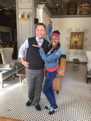 Bubba co-owner Chris Diebel, left, spent some time with actress Erika Alexander on Sunday when she ordered food to go before heading to the airport. Alexander was in Iowa stumping for Hillary Clinton.