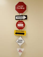 Pre Reid's untitled sculpture of road signs completed to address social issues that voting can change.