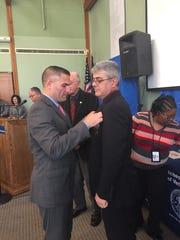 Sgt. Markos Peratikos accepts his medal from Dutchess