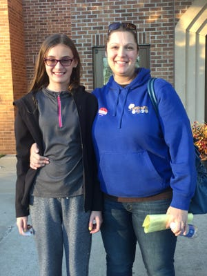 Jamie Kellar stands with her daughter, Lilly Kellar, 12, outside First Lutheran Church after voting on Election Day, Nov. 8, 2016.