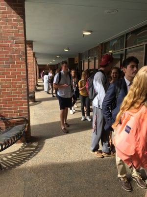 Hundreds of Florida State students wait in line to vote on Election Day. Voters age 18 to 25 make up 22 percent of Leon County registered voters.