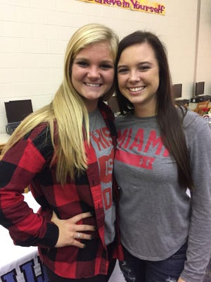 River Valley seniors Claire Nicholson, left, and Morgan Lott signed national letters of intent Wednesday afternoon to play college softball at Ohio State and Miami University next year.