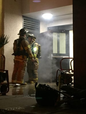 Tallahassee Fire Department firefighters clear smoke from the Salley Hall dorm on Wednesday evening.