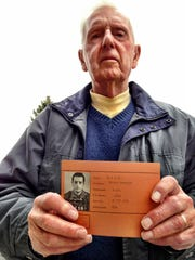 Loren Rice of Great Falls holds his POW identification card from World War II.