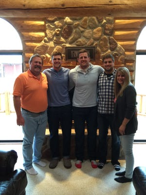 The Watt Family (from left) John, TJ, JJ, Derek and Connie have become a business brand as they've become an athletics powerhouse.