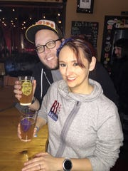 Rob Spengler and Crystal Sullivan of Severna Park, Maryland, enjoy  Huffle Puff bear at Mispillion River Brewery during Saturday's Harry Potter-themed beer release event.