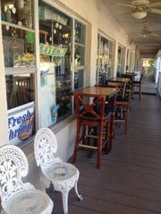 Outside seating on the porch at Sanibel Oasis Cafe East End Deli.