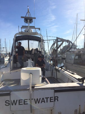 Captain Eric McKee and his crewman Cash Nichols aboard the Sweetwater in Santa Cruz Harbor. In addition to Dungeness crab, McKee fishes for salmon, black cod, halibut, tuna, white sea bass, and rock fish.
