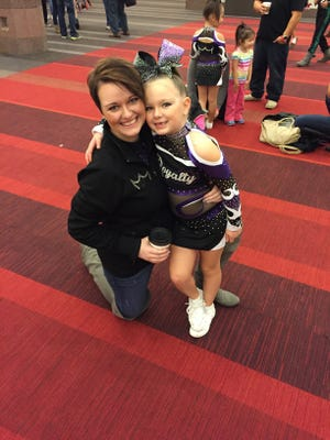 Jennifer Girard, left, and her daughter, Avery, following a recent cheerleading event.