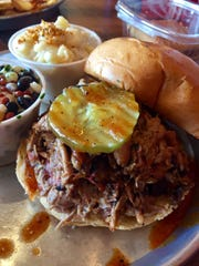 A pulled pork sandwich from the Edley's Bar-B-Cue location