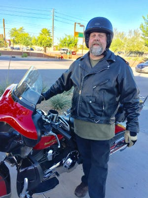 Mark Hovanec, of Chandler, rides his Harley-Davidson motorcycle along Loop 101 to commute to his job in north Scottsdale.