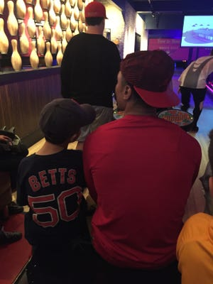 Jude Roberts (left) and Boston Red Sox outfielder Mookie Betts wait for their turn to bowl at a celebrity fundraiser event in Cool Springs on Sunday, Nov. 20, 2016.