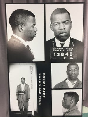 This combination of photographs provided by the Nashville Police Department shows recently discovered never-before-published photos of civil rights icon John Lewis' arrest while leading an effort to desegregate the city's lunch counters in the early 1960's in Nashville. Mayor Megan Barry surprised Lewis with the records Saturday, Nov. 19, 2016, while he was on stage at the Nashville Public Library to receive a literary award.