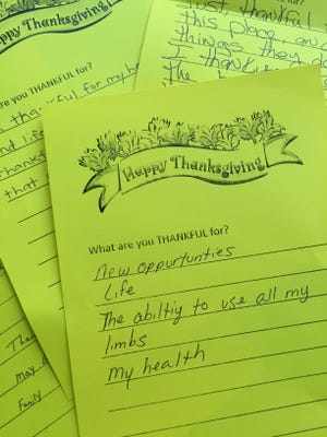 Homeless attendees at a breakfast jotted down their thanks