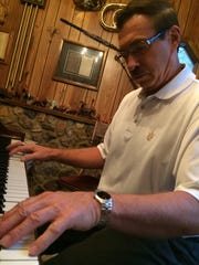 David Zimmerman plays his main piano, a refurbished
