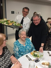 Celebrity wait staff Mayor Lloyd Winnecke and the Rev. Godfrey Mullen were together serving lunch to Janice Decker and other guests at the recent Winter Wonderland event benefitting St. Benedict's.