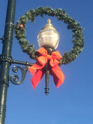 The city of Asheville's Christmas wreaths are more than 20 years old.
