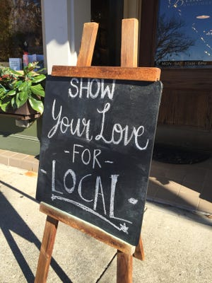 Shop local sign at Trendy Pieces in downtown Murfreesboro.