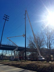 Duke Energy is installing large, new utility poles