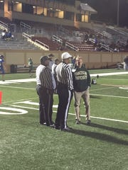 Donahue Academy coach Rich Scanlon talks things over with officials before the start of Saturday's eight-man state championship game in Lakeland. The Shamrocks defeated Kissimmee-City of Life Christian Academy 40-13 for their first-ever state championship.