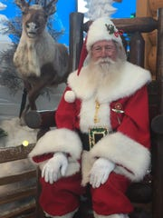 """Paul Kudla, aka Santa Claus, poses for a photo at Bass Pro Shops in Estero. Kudla was named """"America's Best Santa"""" last year on the truTV reality show """"Santas in the Barn."""""""