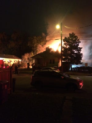 Flames engulf an unoccupied house on E. Main Street in Lafayette's Freetown neighborhood.