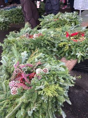 There is more to the Rochester Public Market than food. Vendors offer many products, including holiday wreaths.
