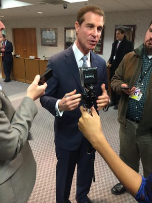 NJ Transit's vice chairman, Bruce Meisel, speaking with reporters after announcing his resignation on Wednesday.