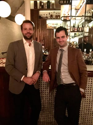 Philip Welker and Ethan Orley, principals of BNA Associates and owners of the Oliver Royale. celebrate at its 1st anniversary party.