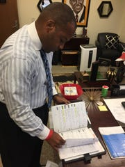 Grambling coach Broderick Fobbs combs through his old notebook, full of his thoughts on building a program, that led to his hiring at Grambling in 2013.