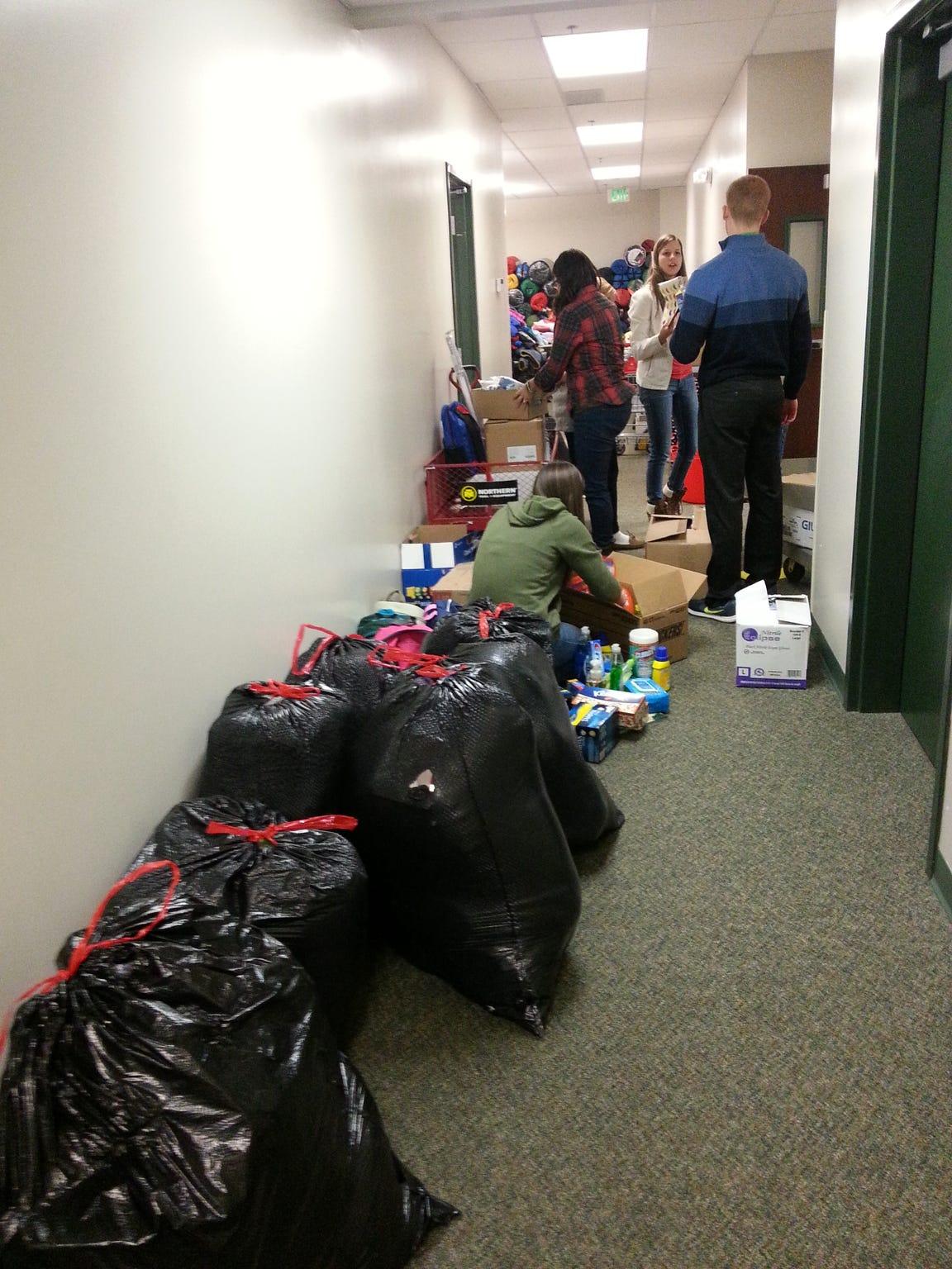 Enterprise High School students peruse a hallway filled
