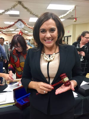 Ann Tovar, 45, is the first Latina mayor of Tolleson. She holds a gavel gifted to her by the city at the inauguration of the new Tolleson City Council on December 13, 2016.