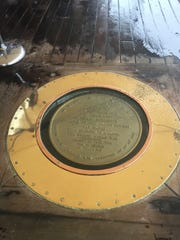 A copper rim surrounds a plaque inset into the teak deck of the Battleship Missouri on the spot where the Japanese and the Allied nations signed the surrender to end World War II in September 1945.
