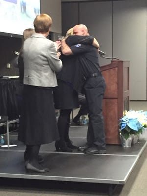 Central Ohio Technical College Basic Police Academy Graduate Aaron Hanson hugs Melissa Osborn after learning he was a recipient of the Thomas W. Cottrell Jr. Award. Osborn is Cottrell's mother.