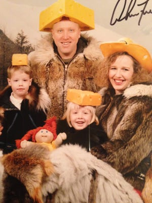 Bobbi Krause, her brother and parents pose for a Christmas photo in their Packers' hats in 1995 at Eielson Air Force Base near North Pole, Alaska.