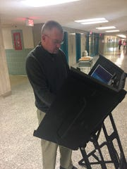 Lebanon County Director of Elections Michael Anderson demonstrates how voting machines are calibrated outside his office in the county courthouse on Dec. 22, 2016.