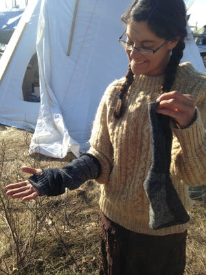Angie Fernandez re-purposes a pair of socks into finger-less gloves.