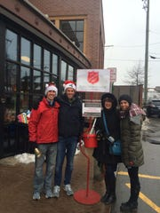 Mark-Thomson, Chris Gragg, Julia Gragg and Carolynn Gragg pose outside of the Kroger at Maple and Woodward.