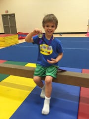 Miles with his gymnastics medal.